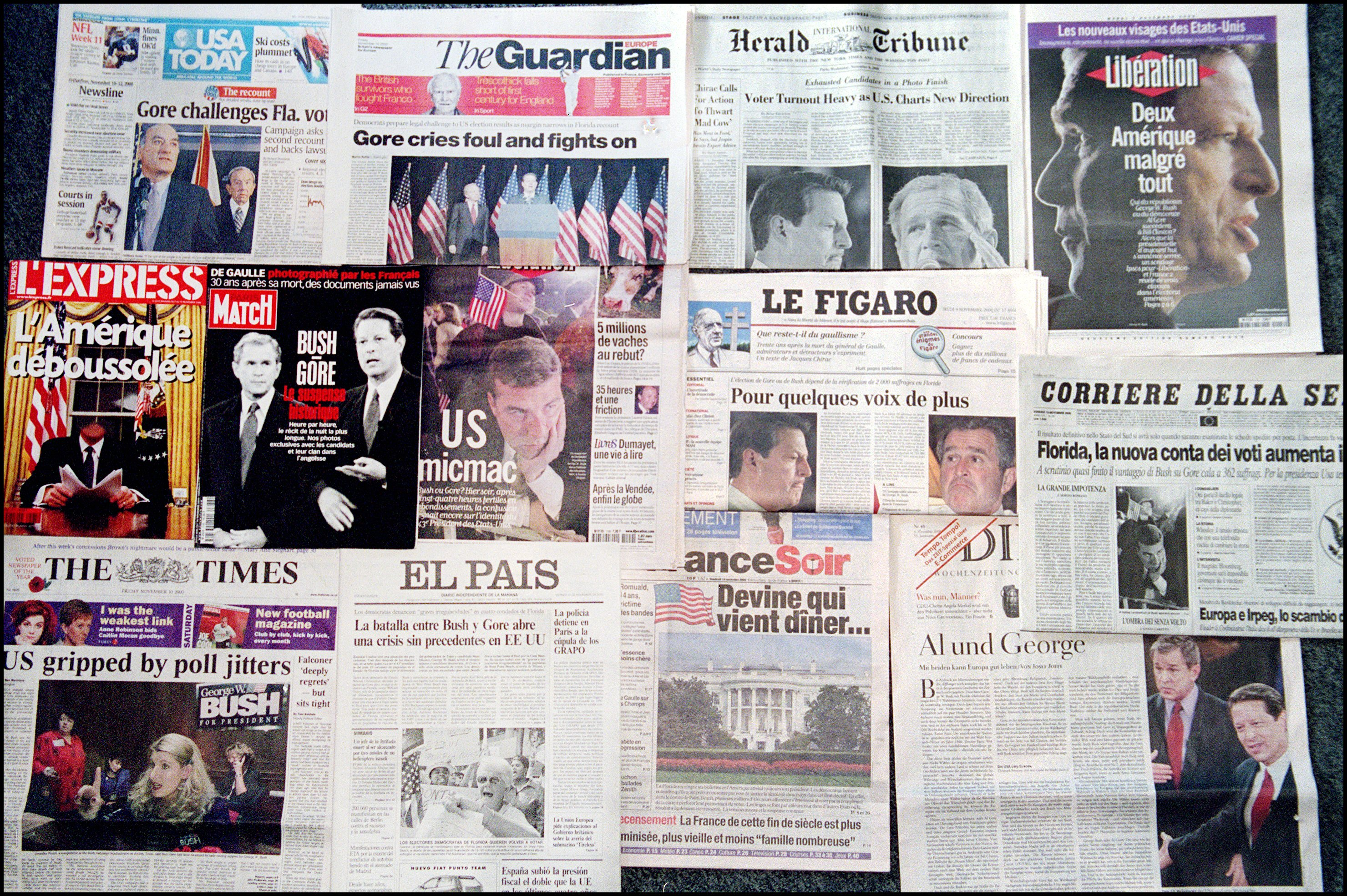 FRANCE - NOVEMBER 10: A Review Of Papers After The Failed Announcement Of U.S. Presidential Run Results On October 11Th, 2000 In Paris, France. (Photo by Alexis DUCLOS/Gamma-Rapho via Getty Images)