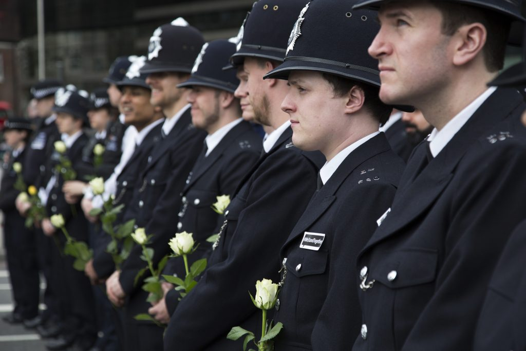 Thousands of people including police officers and Muslim faith leaders gathered on Westminster Bridge to hold a vigil and a minutes silence one week after the terror attack, on March 29th 2017 in London, United Kingdom. Metropolitan Police stand in lines holding white roses in memory of their colleague and members of the public. (photo by Mike Kemp/In Pictures via Getty Images)
