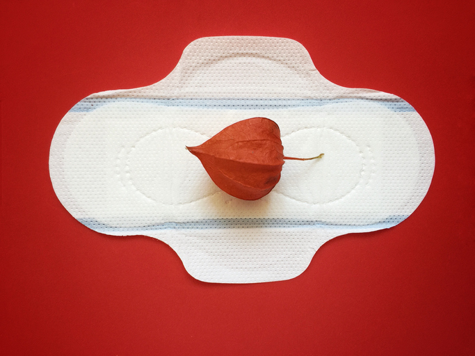 Sanitary pad with red drop shaped Berry on it
