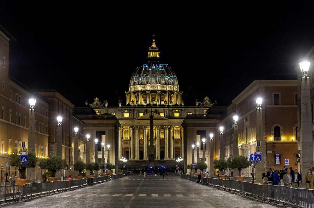 "ROME, ITALY - MAY 23: On the occasion of the meeting between Pope Francis and US President Donald Trump, Greenpeace projected the message ""Planet Earth First"" on the St. Peter's Dome in response to Trump's motto ""America First"" on May 23, 2017 in Rome,Italy. The Greenpeace protest is due to the abolition of numerous climate protection measures to encourage US and US coalition companies wanted by US President Donald Trump. (Photo by Stefano Montesi/Corbis via Getty Images)"
