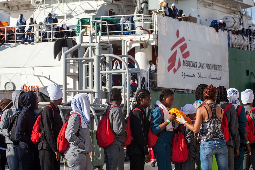 PALERMO, ITALY - 2016/10/05: Over 1,000 African migrants arrive at the port of Palermo. The migrants were rescued by a crew on a Doctors Without Borders ship. By tomorrow, over 6,000 African migrants in total are expected to land in other ports throughout Italy. (Photo by Antonio Melita/Pacific Press/LightRocket via Getty Images)