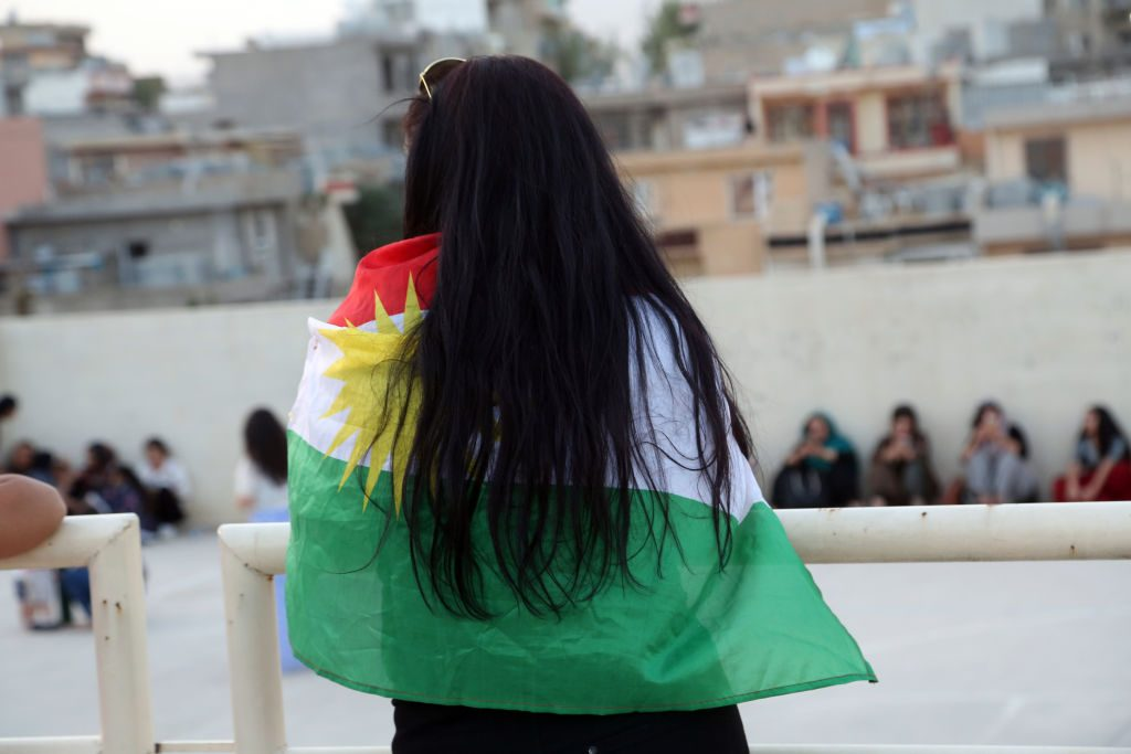 SULAYMANIYAH, IRAQ - 2017/09/25: A young Kurdish girl is pictured while wearing a Kurdish flag. September 25, 2017 is a historic day for Kurdish people around the world as many Kurdish took part in a landmark vote on independence for Iraq's Kurdistan region. Votes are currently still being counted, with an expected victory for YES. The referendum runned off quietly in the three provinces that make up the region, and in places controlled by Kurdish forces. The Kurdish Rudaw website published recently that more than 90% have voted for independence. (Photo by Rahman Hassani/SOPA Images/LightRocket via Getty Images)